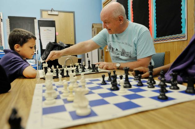 Fourth grader, Jaiden Rodriguez, left, learns chess from John McManus with The Right Move during a Project Based Learning program at Troy School 2 on Wednesday, May 13, 2015, in Troy, N.Y. The program is a 6-week program that meets on Wednesday afternoons for Grades three through five. (Paul Buckowski / Times Union)