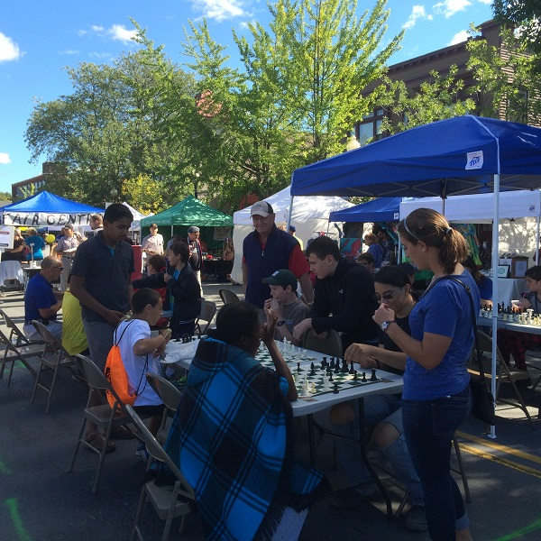 Executive Director Brother John McManus and President Sandeep Alampalli watching chess games at the fair